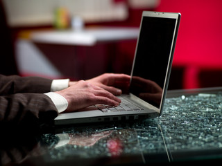 man's hands and laptop