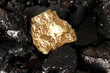 Golden nugget on coals background close-up