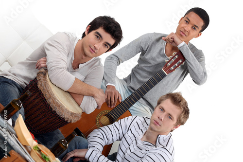 Young men jamming with instruments