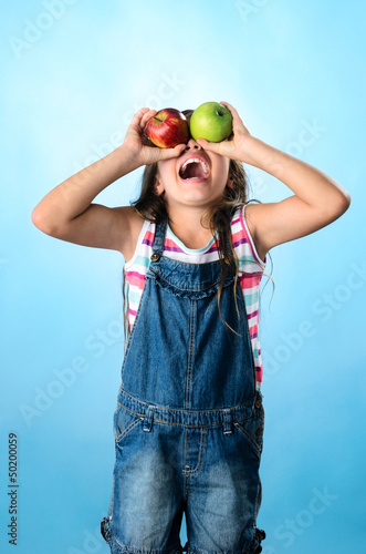 Happy Child with red and green apple