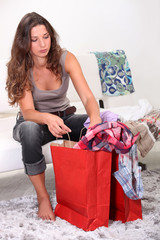girl at home after shopping frenzy