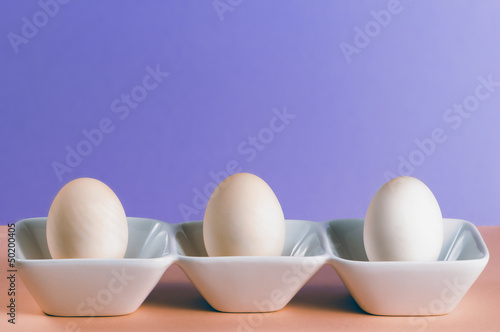 Three duck eggs in a white porcelain dish 2