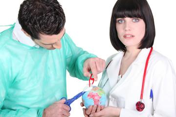 Doctors healing a globe