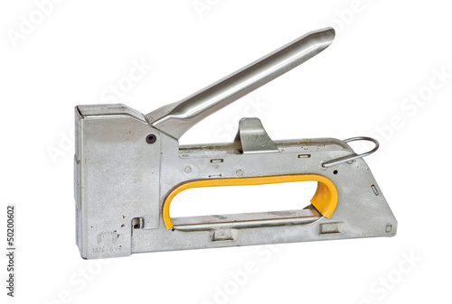 The old staple gun on white background.