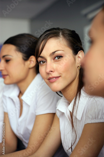Three brunettes having business meeting