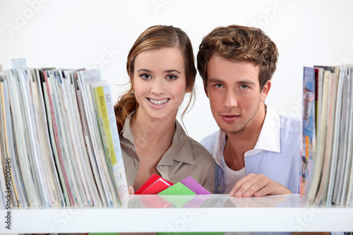 Young couple in library
