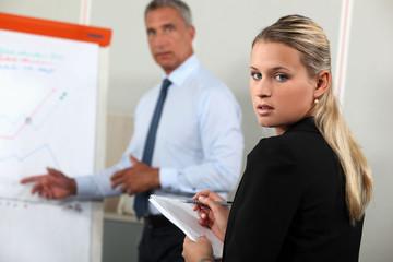 Boss giving presentation via flip-chart
