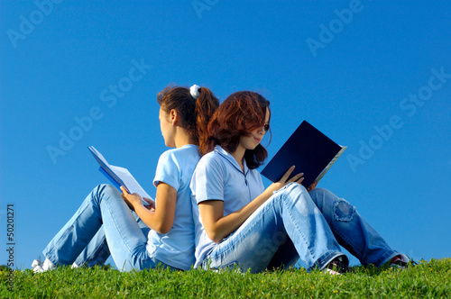 Two students studying in the nature