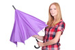 Young woman opening a purple umbrella