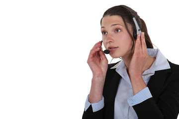 A businesswoman answering a hotline.