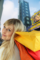 blonde carrying shopping bags on shoulder