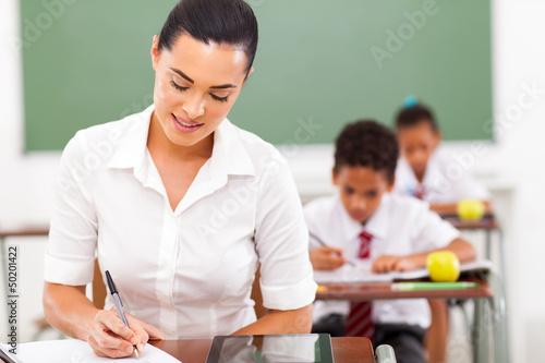 teacher preparing lessons in classroom