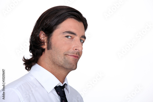 Closeup of a man in a shirt and tie
