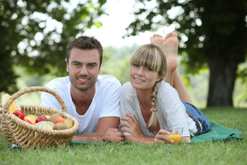 Couple with a basket of fruit