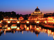 Night view of the Vatican across the Tiber River of Rome, Italy