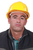A bored construction worker.