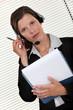 Call-center agent holding folder