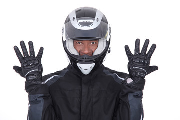 Motorcyclist wearing black jacket, gloves and helmet