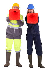 Two traffic workers shouting through cones