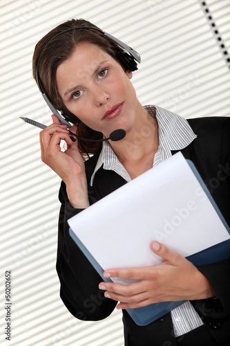 Call-center agent holding folder