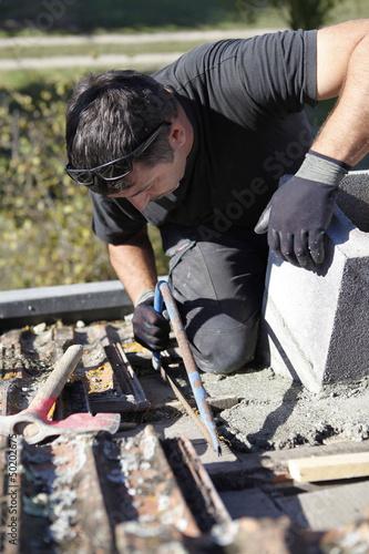 Roofer hard at work
