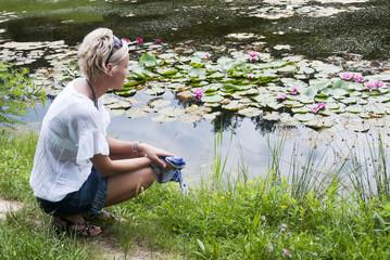 Beautiful woman near the lake