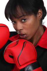 black woman with boxing gloves