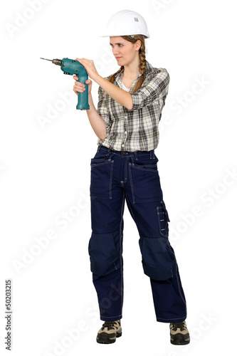 Tradeswoman using a drill