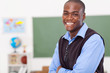 primary male teacher in classroom