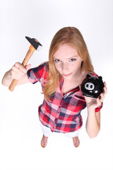 Teenager with hammer and piggy-bank