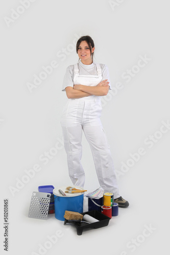Stern looking decorator stood with equipment