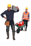 Man with traffic cones and wheelbarrow