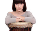 Woman leaning on a djembe