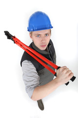 Menacing tradesman holding large clippers