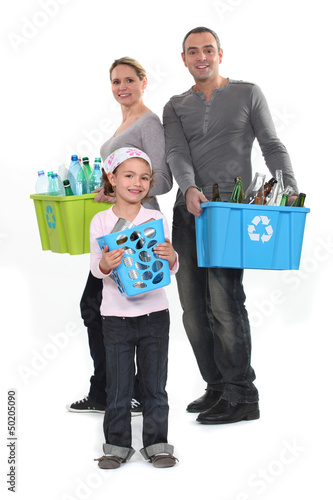 Family sorting garbage, studio shot
