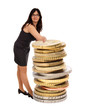 Business woman is based on a stack of money