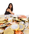 Business woman draws on euro coins