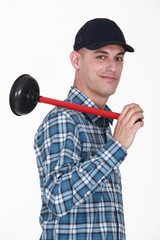 Smiling plumber holding ventouse