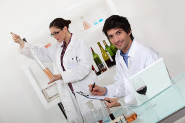 female and male wine laboratory technicians