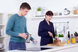 young man and happy  woman preparing breakfast in their kitchen