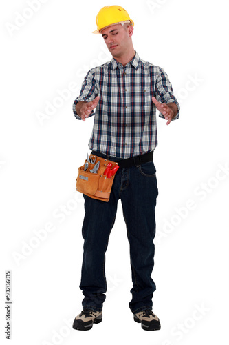 Tradesman holding an invisible object