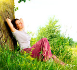 Beautiful Young Woman Relaxing outdoors. Nature