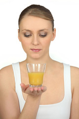 Woman with glass of orange juice in hand