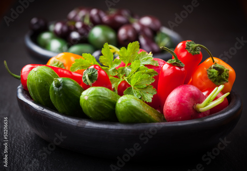 Raw snack vegetable with olives