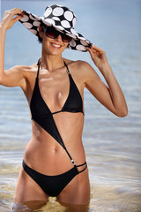sexy brunette in black bikini with assorted sun hat