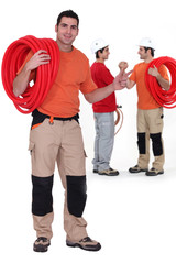 Three male plumbers