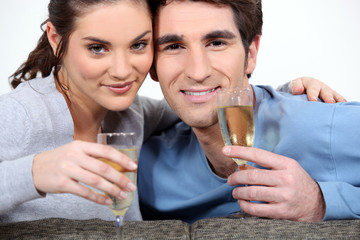 Couple drinking champagne to celebrate anniversary