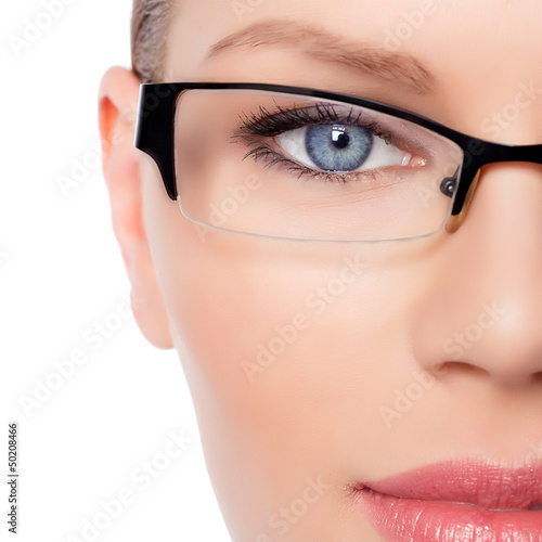 Attractive Young Optician Woman With Blue Eyes  In Glasses