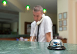 Hotel reception desk with a bell