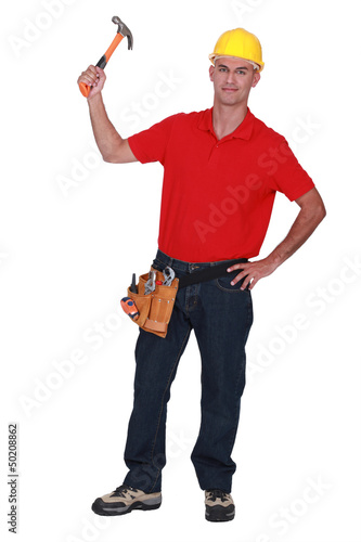Young handyman raising hammer in the air